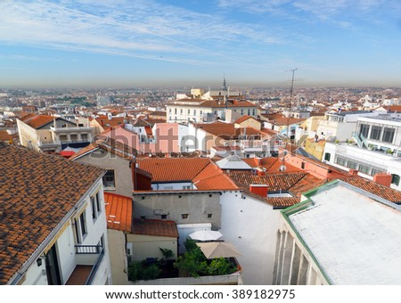 panorama metropolitan Madrid Spain Europe with red tile roof condos offices and Cathedral       - stock photo