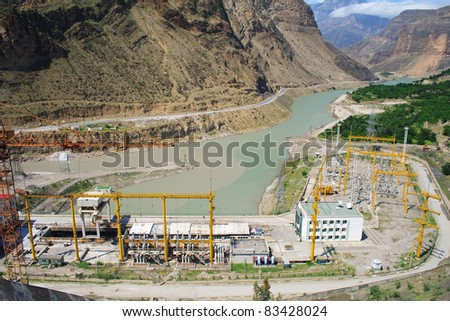 Panorama of hydro power plant with substation. Mountains. Russia - stock photo