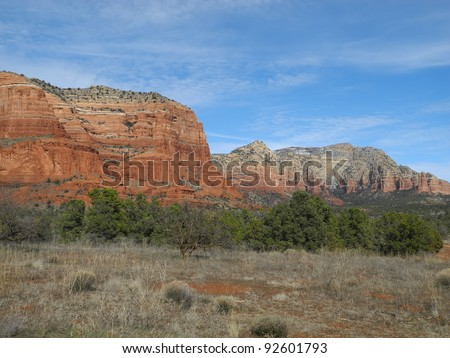 Panoramic views of the mesas and canyons around Sedona, make Arizona a photographer's paradise, a dramatic mix of rough brush and trees and rugged red-rock terrain. - stock photo