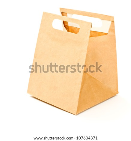 Paper brown lunch bag isolated - stock photo