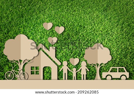 Paper cut of family on green grass - stock photo