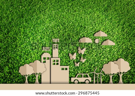 Paper cut of Green city concept on green grass - stock photo