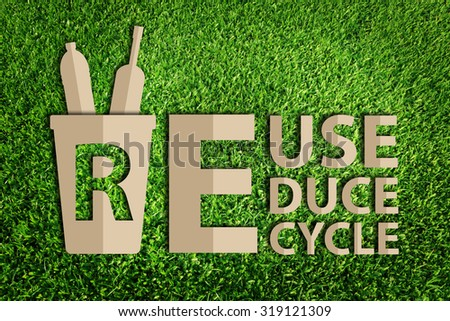 Paper cut of Reuse, Reduce, Recycle concept on green grass - stock photo