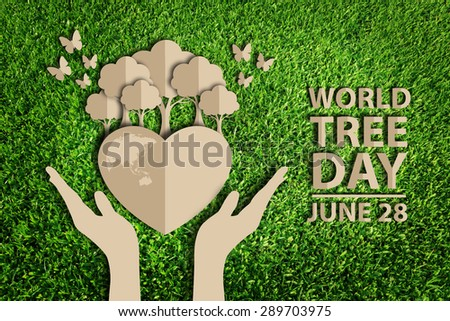 Paper cut of World tree day concept on green grass - stock photo