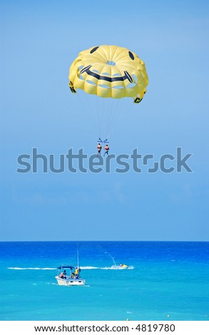 parasailing in cancun - stock photo