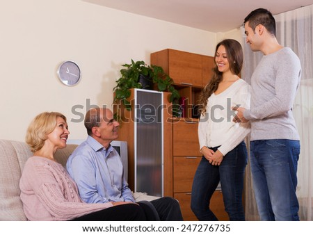 parents meeting girlfriend of their son in the everning - stock photo