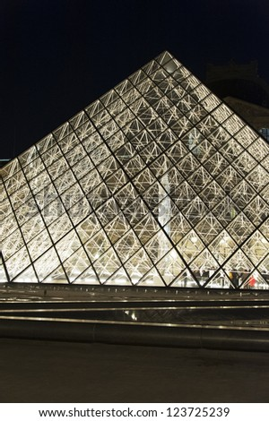 PARIS - OCT. 31:  The glass pyramid entrance to the Louvre museum in Paris at night  on October 31, 2012 in Paris, France. Louvre is the biggest Museum in Paris displayed over 60,000 square meters - stock photo