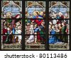 Paris - windowpane from Saint Severin gothic church - Jesus with the children - stock photo