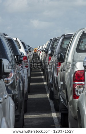 Parking lot full of new pick-up truck, panama, Central America - stock photo