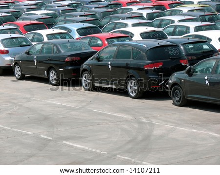 parking of new cars prepared for transportation in port of Barcelona, Spain - stock photo