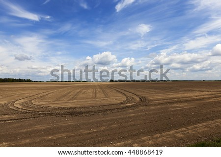 part of an agricultural field prepared for sowing crops. empty field. plow