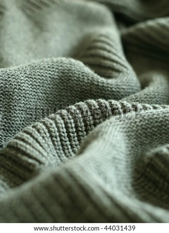 part of grey knitted wool - stock photo