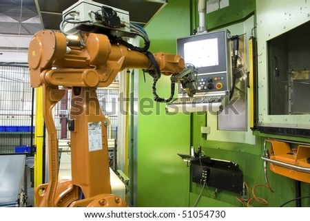 part of the cnc milling machine with control panel and robot
