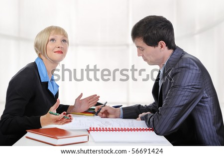 partners at the negotiating table in the office. - stock photo