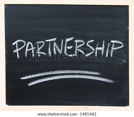 """Partnership"" word written on the chalkboard."