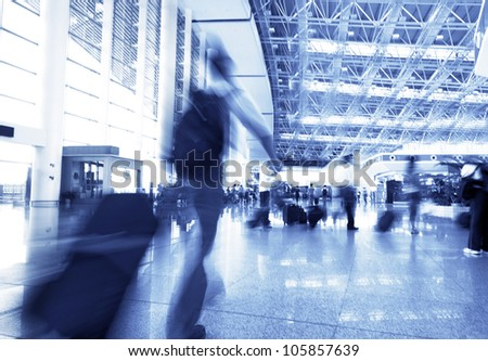 passenger in the shanghai pudong airport,interior of the airport. - stock photo