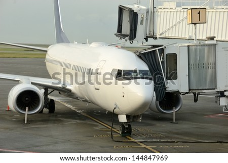 Passenger Jet.  A passenger jet is being prepared for its next flight. - stock photo
