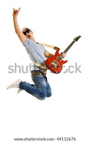 Passionate guitarist with sunglasses and hat jumps isolated on white - stock photo