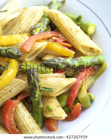 Pasta in roasted asparagus, peppers with green pesto