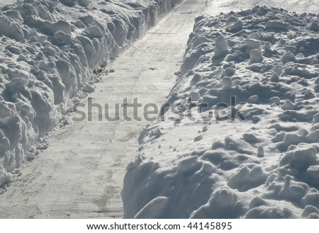 path shoveled of deep snow - stock photo