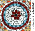 Pattern of a mosaic in the form of a circle on a street wall . Bright, decorative and colorful tiles and splinters. Old Tel Aviv, Israel - stock photo
