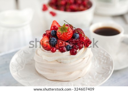 Pavlova meringue cake with fresh berries on white background - stock photo
