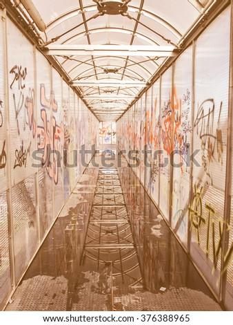 Pedestrian bridge with graffiti on its walls vintage - stock photo