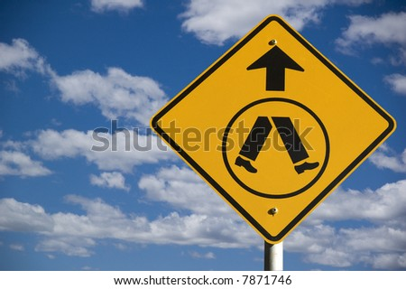 """""""pedestrian"""" road warning sign against a blue sky background with copyspace to the right - stock photo"""