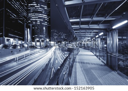 Pedestrian transition over busy street in Central district in Hong Kong - stock photo