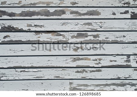"""Peeling Paint"" Peeling paint on old wooden siding on this historic home. - stock photo"