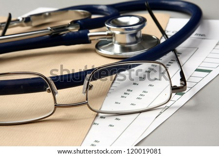 Pen stethoscope and glasses
