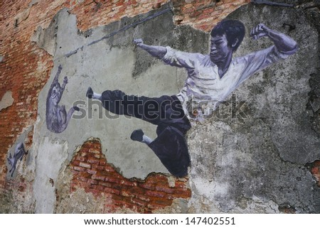 PENANG, MALAYSIA-JULY 9 :General view of a mural 'The Real Bruce Lee Would Never Do This' painted by 101 Lost Kittens in Penang on JULY 9,2013.The mural is 1 of the 11 murals paintings in early 2012. - stock photo