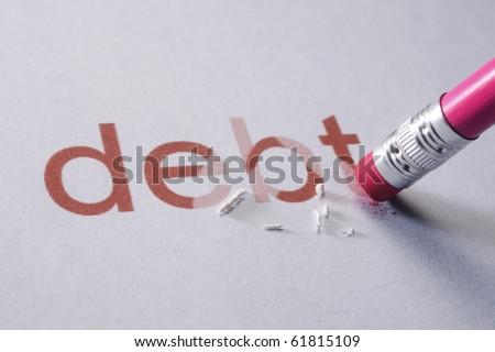 pencil erasing the word-debt - stock photo