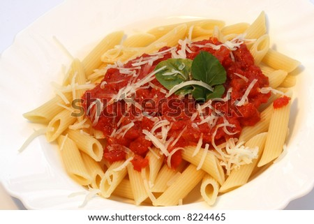 """""""Penne all arrabbiata"""" pasta with piquant tomato sauce and grated cheese - stock photo"""