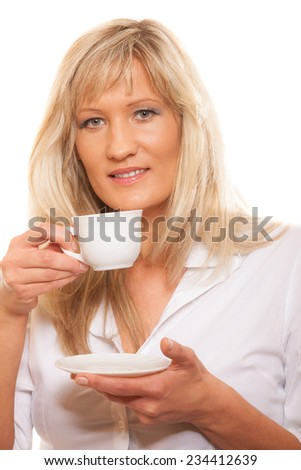 People, happiness, drink and food concept. Mature woman drinking tea or coffee. Cup of Hot Beverage. white background