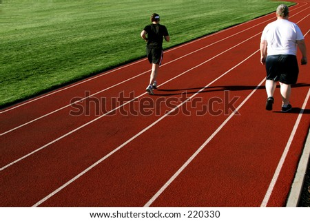 2 people on a racetrack - stock photo