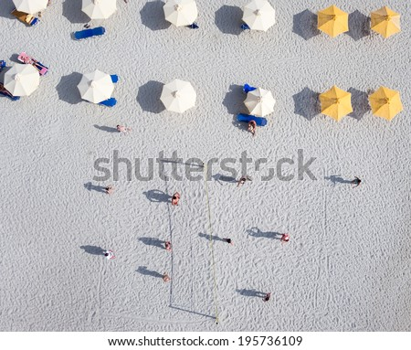 People playing beach volley at the beach of Kallithea, one of the most visited destinations in Greece. Top View  - stock photo