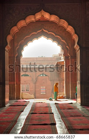 People praying at the Jama Masjid Mosque, old Delhi, India. - stock photo