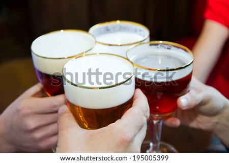 People toasting with a delicious Pale Ale Beer  - stock photo