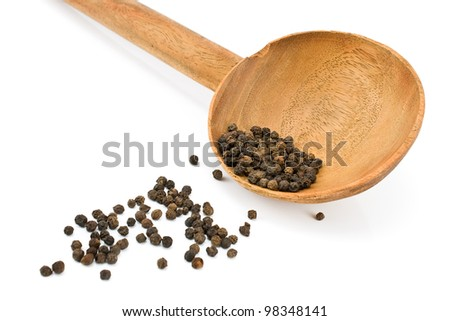 Pepper in wooden spoon isolated on white - stock photo