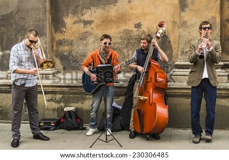 Performance of street musicians in the center of Lviv,Ukraine,  May 10, 2014 - stock photo