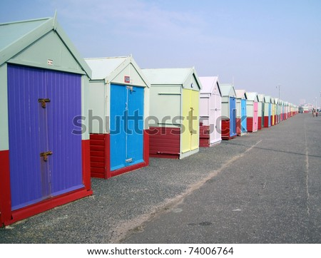 Perspective of beach huts wind and rain protection - stock photo