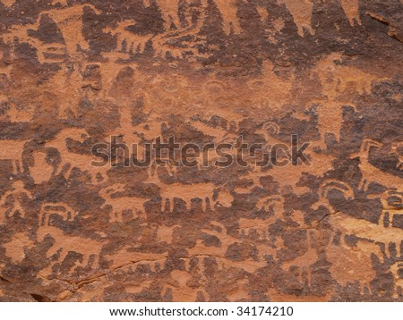 Petroglyphs carved into rock surface by prehistoric Native Americans, Canaan Gap, northern Arizona, USA. - stock photo