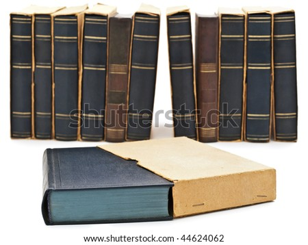 Photo of old books row at white background - stock photo