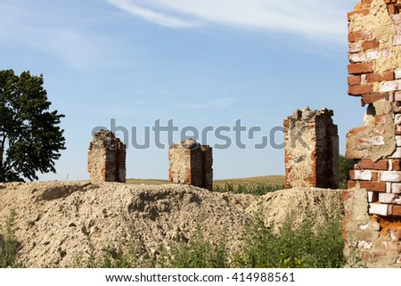 photographed close-up of an old brick wall crumbling building - stock photo