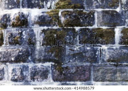 photographed close-up of an old brick wall crumbling structure, Defocus - stock photo