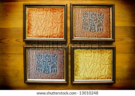 picture frames with leather texture on wooden wall - stock photo
