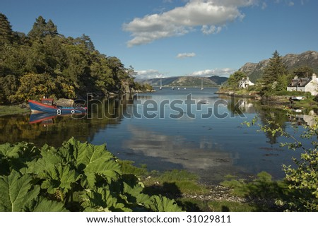 picturesque bay with houses and boat near plockton, Scotland - stock photo