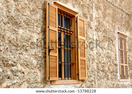 Picturesque windows with wooden jalousie