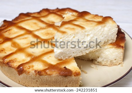 Pie with curd on the shortcake in a plate. - stock photo